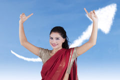 Young Indian businesswoman with upward arrow Royalty Free Stock Photos