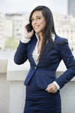 Young Indian businesswoman using cell phone Stock Photos
