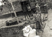 Young Indian children in a poor rural village in India Royalty Free Stock Images