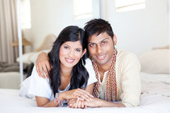 Young indian couple. Loving young indian couple in traditional clothing and lying on bed Stock Images