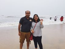 A young Indian couple in the beach at Kunoor. A young Indian couple posing with a smile, at a Kunoor beach Stock Image