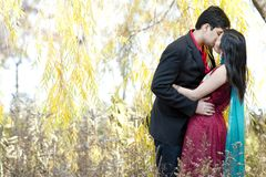 Young Indian Couple Kissing Royalty Free Stock Photos