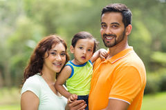 Young indian family. Young happy indian family with the kid outdoors Royalty Free Stock Photography