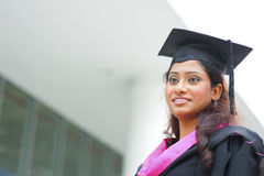 Young Indian female graduate. Smiling young Indian female graduate looking away Royalty Free Stock Image
