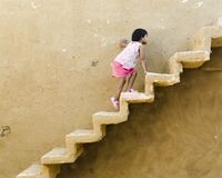 Free Young Indian Girl Climbing The Stairs Of An Abandoned House In Kuldhara Village  Jaisalmer  Rajasthan  India Stock Photo - 204066350