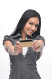 Young indian girl with credit-card Royalty Free Stock Photography
