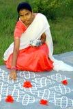 Young indian girl drawing a kolam Stock Images