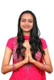 Young Indian girl in namaste pose. Stock Photos