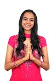 Young Indian girl in namaste pose. Royalty Free Stock Photography