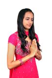 Young Indian girl in namaste pose. Stock Image