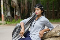Young Indian girl with short hair wearing headgear and posing for camera, Pune stock photography