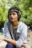 Young Indian girl with short hair wearing headgear and posing for camera, Pune royalty free stock image