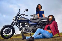 Young Indian girls posing on motorcycle, Pune stock photography