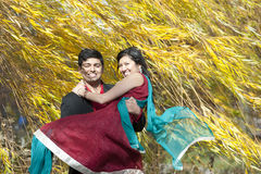Young Indian Man Carrying His Bride Royalty Free Stock Image