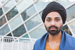 Young Indian man posing in an urban context Royalty Free Stock Photo