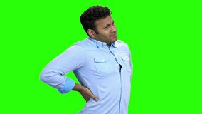 Young Indian man suffering from back ache. stock footage