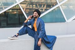 Young Indian man talking on phone Royalty Free Stock Photo