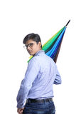 Young indian man with umbrella Royalty Free Stock Image