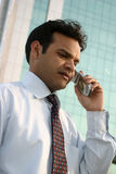 Young indian on mobile phone Stock Photos
