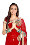 Young Indian in a namaste(greeting) pose. Stock Photos
