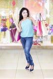 Young indian shopaholic in shopping center Stock Photos