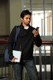 Young Indian Srudent Using Cellphone Royalty Free Stock Photo