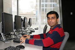 Young Indian student. Young Indian student working on his laptop in the university Stock Images