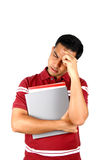Young Indian student holding his head in stress. Stock Photo