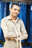 Young indian tailor man Stock Image