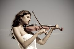 Young indian violin player Royalty Free Stock Photo