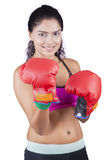 Young Indian woman with boxing gloves Stock Photography