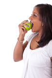 Young indian woman eating an apple Royalty Free Stock Photo