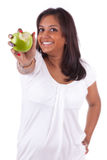 Young indian woman eating an apple Stock Images