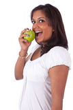 Young indian woman eating an apple Royalty Free Stock Photography