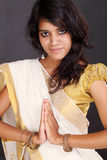 Young Indian woman greeting NAMASTE Royalty Free Stock Images