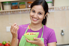 Young Indian woman in her kitchen Royalty Free Stock Photography