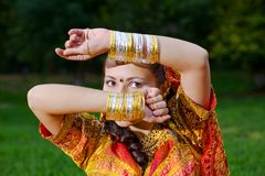 A young Indian woman hiding face Stock Images