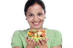 Young Indian woman holding fruit salad bowl Royalty Free Stock Photos