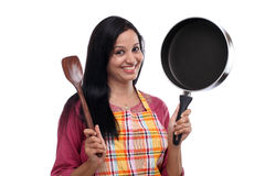 Young Indian woman holding kitchen utensil Stock Photos