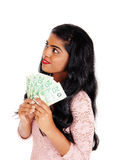 Young Indian woman holding money. Royalty Free Stock Photos