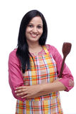 Young Indian woman holding wooden spoon Stock Photo