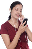 Young Indian woman listening music Stock Images