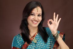 Young indian woman making OK sign Stock Images