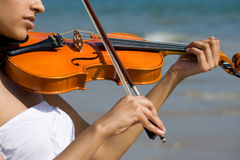 Young indian woman play violin Stock Photography