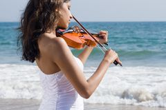 Young indian woman play violin stock images