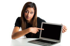 Young Indian woman pointing to laptop. Royalty Free Stock Photography