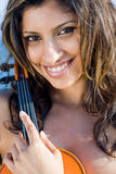 Young indian woman portrait with violin Stock Photos