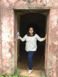 A young Indian woman posing gracefully at an entrance. To a historic fort in Kunoor, Kerala Stock Photography