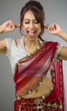 Young Indian woman shouting in frustration. Adult indian woman in studio isolated on grey background Stock Photos