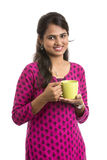 Young Indian woman with tea cup Stock Images